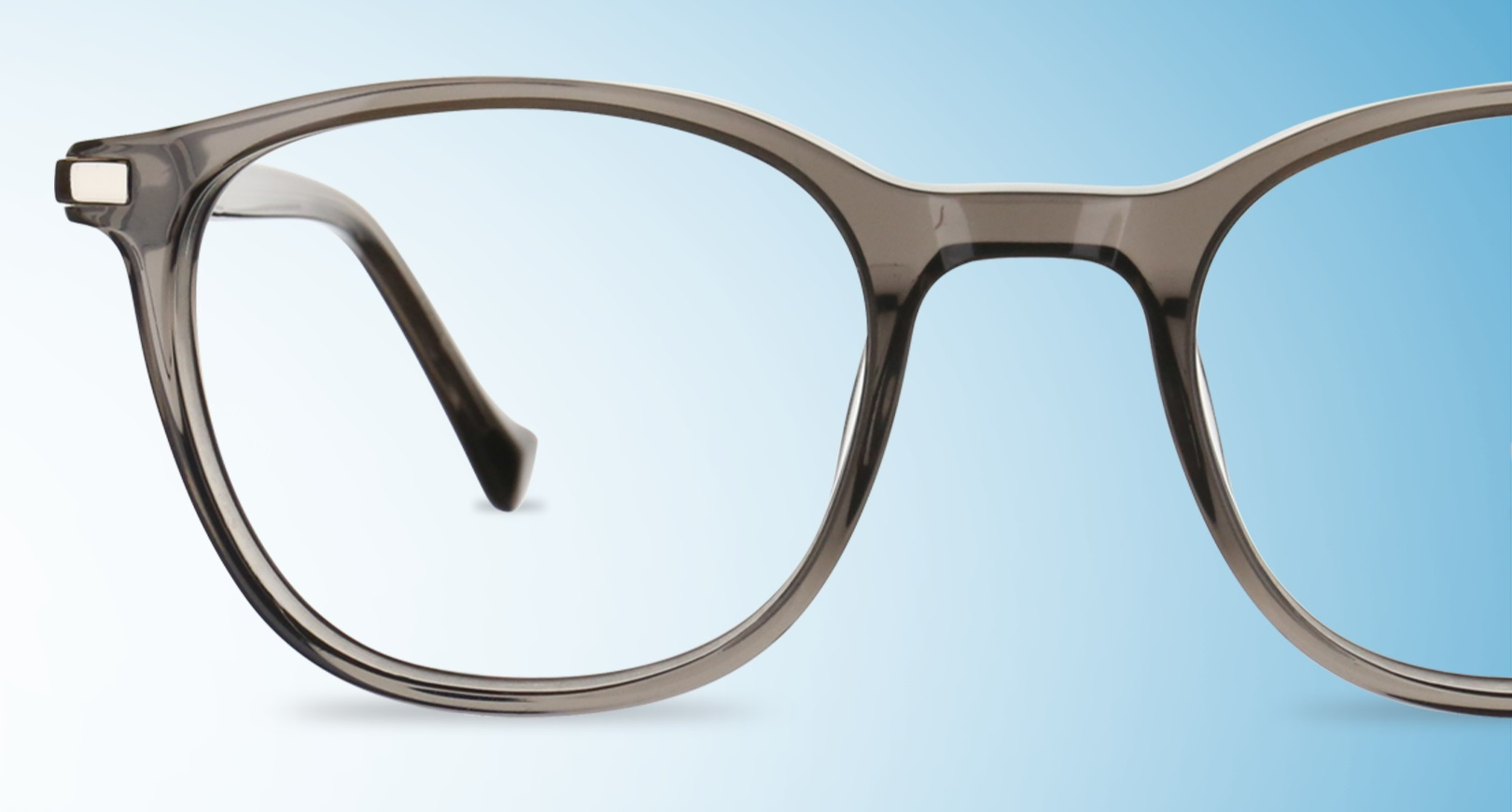 Grey glasses on blue background
