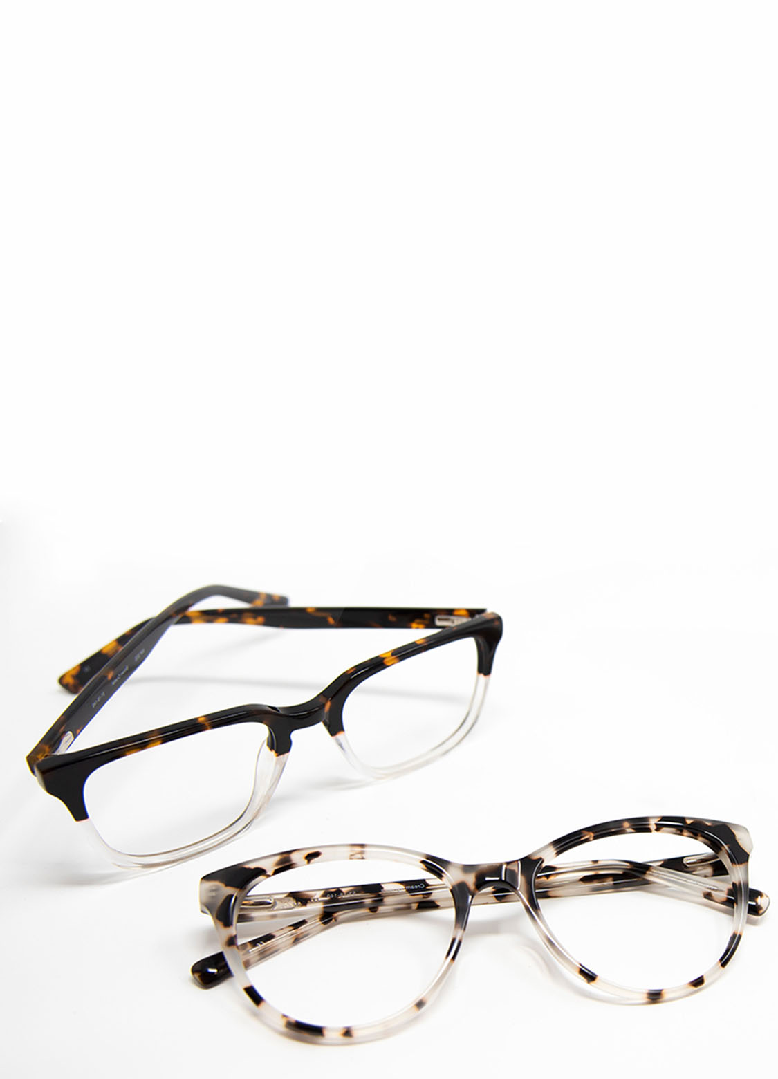 3 pairs of trendy glasses on white table
