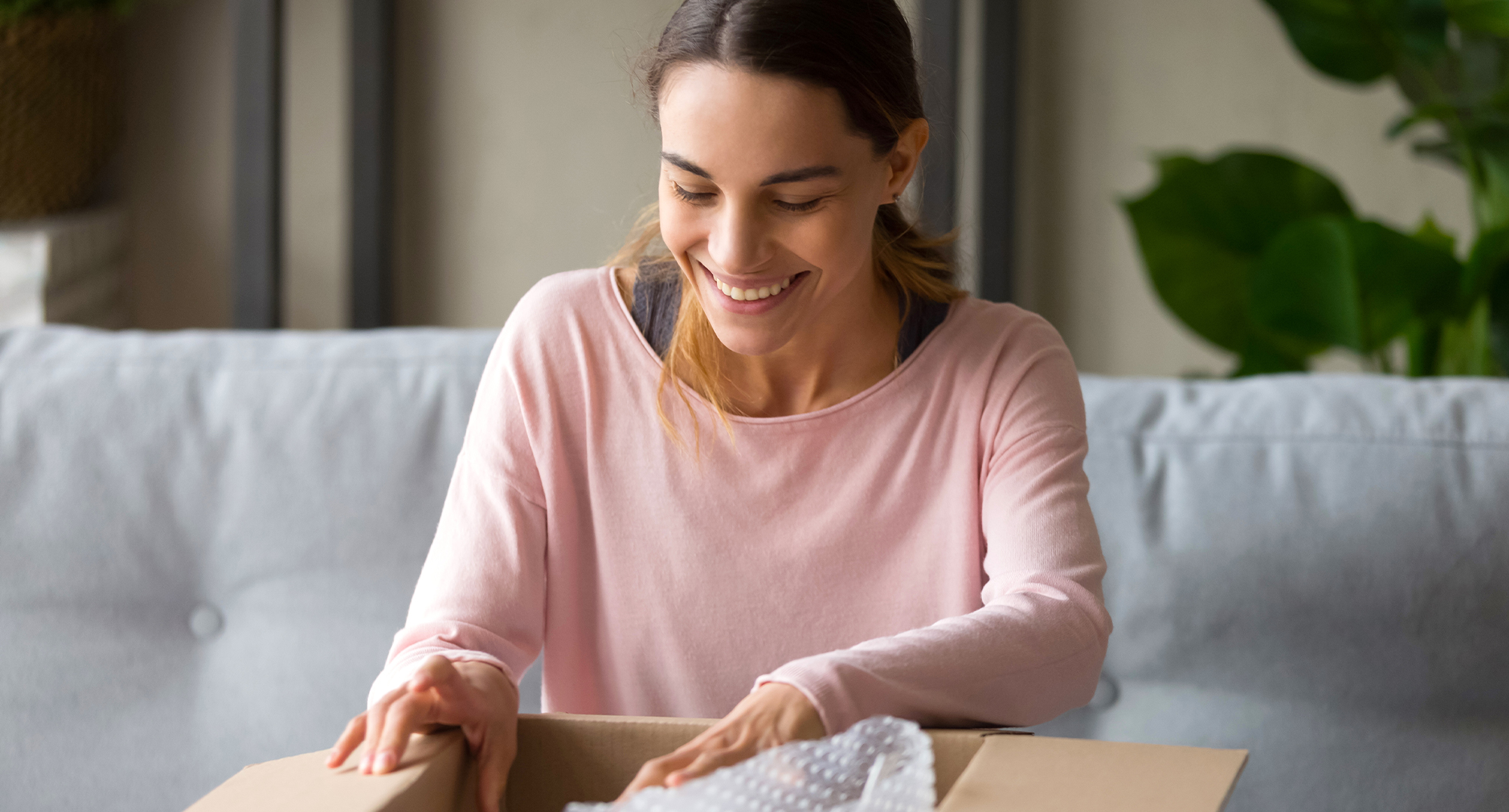 woman opening shipping box