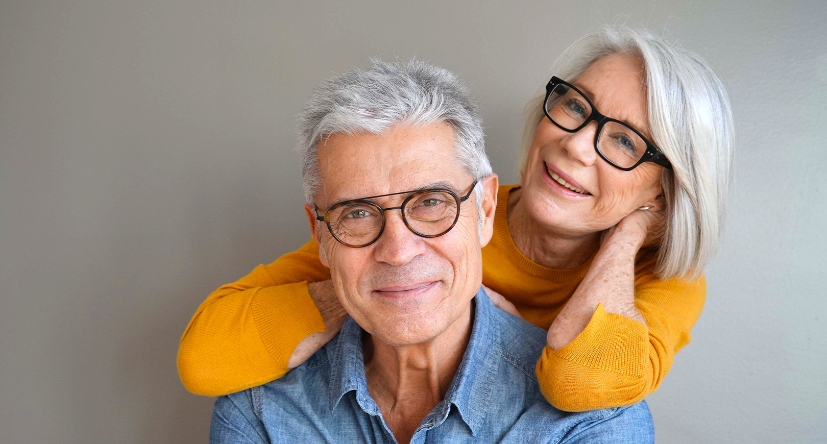 Mature man and woman wearing glasses