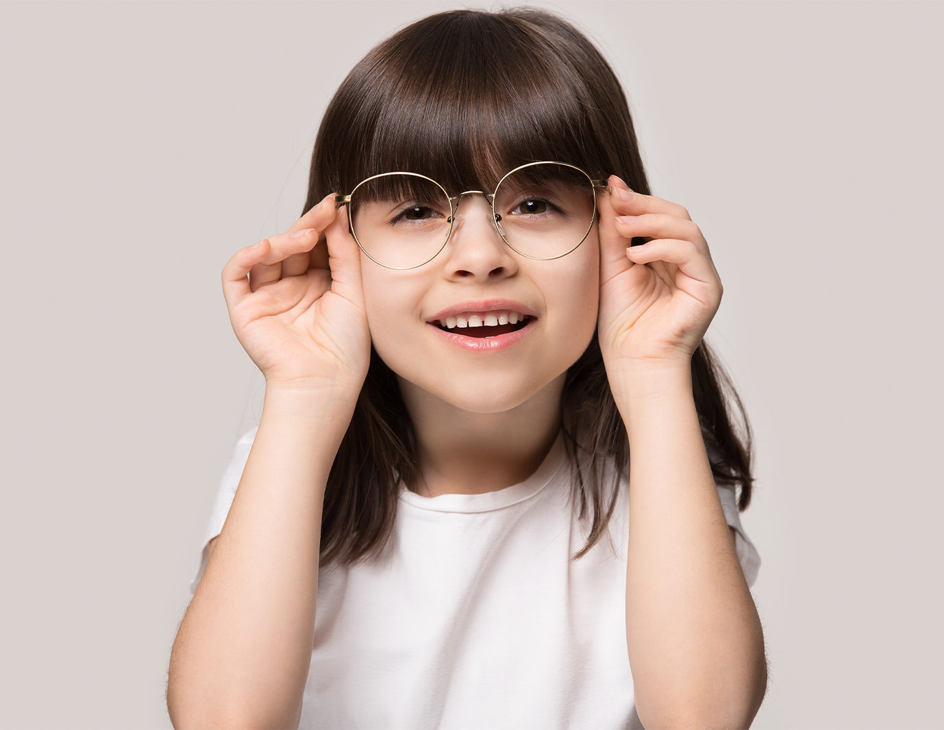 Young girl wearing a pair of glasses